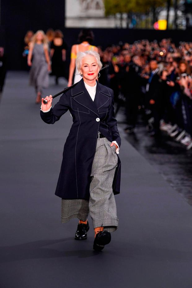 British actress Helen Mirren takes part in the L'Oreal fashion show, which theme is Paris, on the sidelines of the Paris Fashion Week on October 1, 2017, on a catwalk set up on the Champs-Elysees avenue in Paris. / AFP PHOTO / CHRISTOPHE SIMONCHRISTOPHE SIMON/AFP/Getty Images
