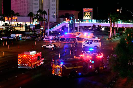 Police and rescue personnel gather at the intersection of Las Vegas Boulevard and Tropicana Ave. (Photo by Ethan Miller/Getty Images)
