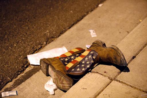 A pair of cowboy boots is shown in the street outside the concert venue after a mass shooting at a music festival on the Las Vegas StripY