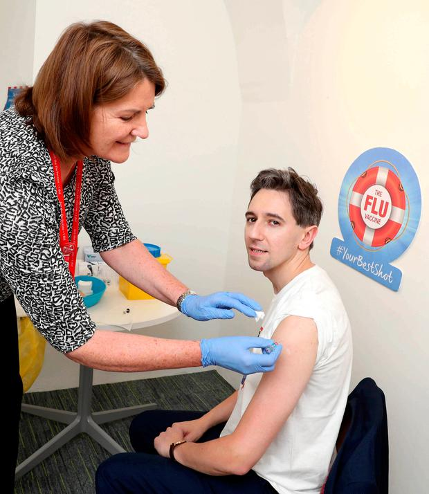 Health Minister Simon Harris receives the vaccine at the launch of the HSE annual flu vaccine campaign for healthcare workers yesterday