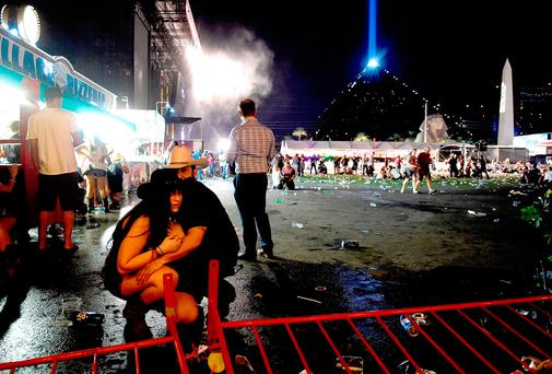 People take cover at the Route 91 Harvest country music festival in Las Vegas, Nevada as the gunman fires round after round. Photo: David Becker/Getty Images