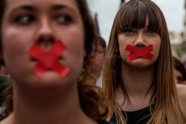Students hold a silent protest against the violence Photo: Getty