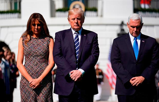 U.S. President Donald Trump stands with first lady Melania Trump and Vice President Mike Pence during a moment of silence in the wake of the the mass shooting in Las Vegas at the White House in Washington, U.S., October 2, 2017. REUTERS/Joshua Roberts
