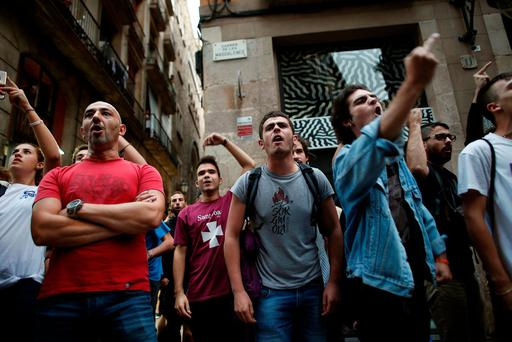 Demonstrators gesture during a protest against Spanish National Police officers. REUTERS/Jon Nazca