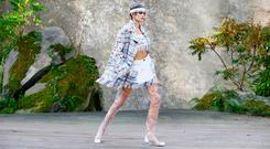 Kaia Gerber wears a creation for the Chanel Spring/Summer 2018 ready-to-wear fashion collection presented in Paris, Tuesday, Oct., 2017. (AP Photo/Francois Mori)