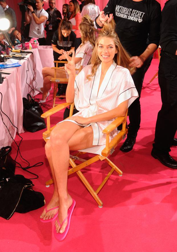 Victoria's Secret model Jessica Hart prepares at the 2013 Victoria's Secret Fashion Show hair and makeup room at Lexington Avenue Armory on November 13, 2013 in New York City. (Photo by Jamie McCarthy/Getty Images)