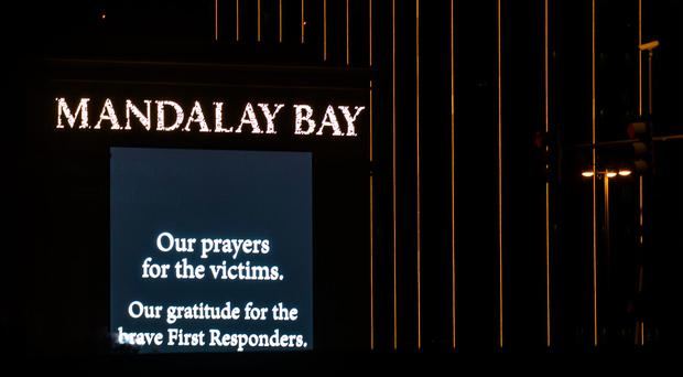 LAS VEGAS, NV - OCTOBER 2: A condolence message is displayed on signage from the Mandalay Bay Resort and Casino, October 2, 2017 in Las Vegas, Nevada. Late Monday night, a lone gunman killed at least 59 people and injured 527 people after he opened fire on a large crowd at the Route 91 Harvest Festival, a three-day country music festival. The massacre is one of the deadliest mass shooting events in U.S. history. (Photo by Drew Angerer/Getty Images)