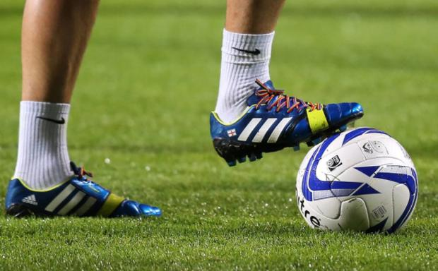 Players have worn rainbow laces in a bid to promote inclusion and diversity in football. CREDIT: GETTY IMAGES