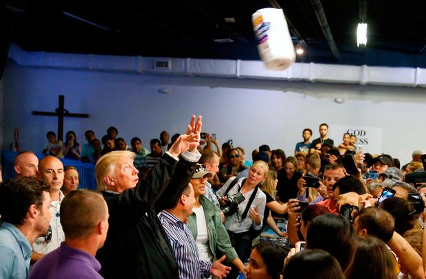 U.S. President Donald Trump throws rolls of paper towels into a crowd of local residents affected by Hurricane Maria as he visits Calgary Chapel in San Juan, Puerto Rico, U.S., October 3, 2017. REUTERS/Jonathan Ernst