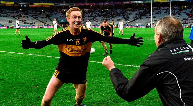 Colm Cooper rushes to celebrate with manager Pat O'Shea after Dr Crokes' victory over Slaughtneil in the All-Ireland Club SFC final. Photo: Brendan Moran/Sportsfile