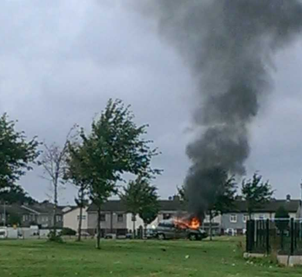 The car in flames by St Mark's GAA pitch