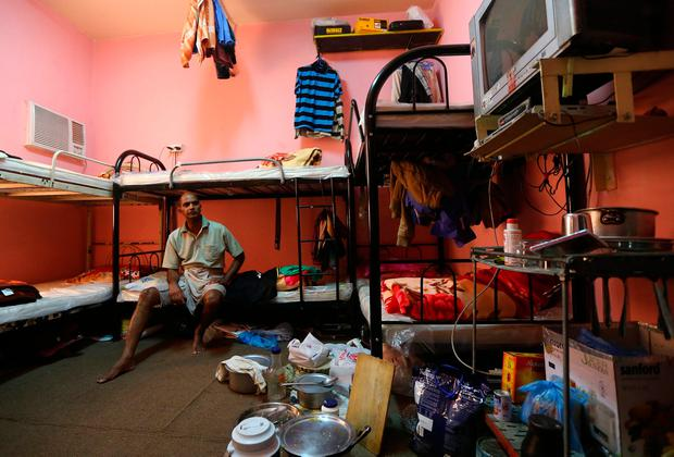 Kupttamon, an Indian labourer working in Qatar, sits in his tiny, over-crowded room at a private camp housing foreign workers in Doha two years ago. Photo: GETTY IMAGES