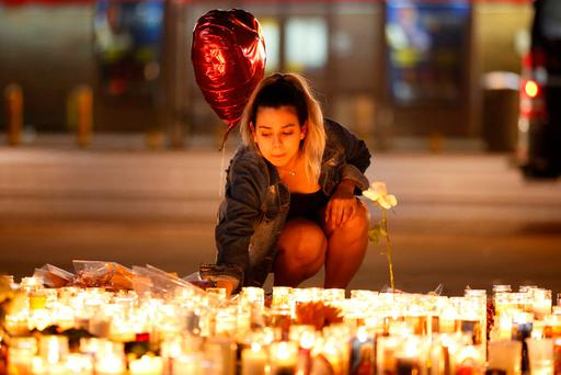 A woman lights candles at a vigil on the Las Vegas Strip following the mass shooting. Picture: Reuters