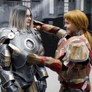 Cosplayers dressed as Ironman attend London Super Comic Convention at Business Design Centre in Islington, London on August 26, 2017. / AFP PHOTO / Tolga AKMEN (Photo credit should read TOLGA AKMEN/AFP/Getty Images)