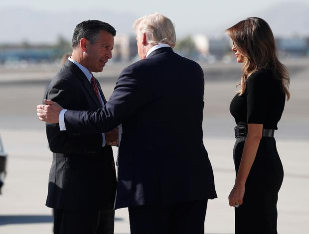 U.S. President Donald Trump and first lady Melania Trump are greeted by Nevada Governor Brian Sandoval