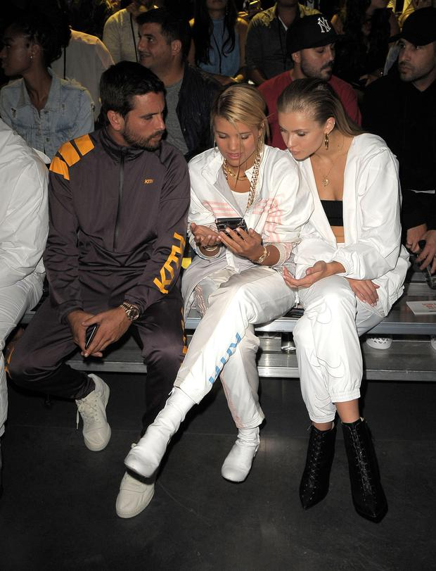 (L-R) Scott Disick, Sofia Richie and Josie Marie Canseco attend Kith Sport fashion show during New York Fashion Week at the Classic Car Club on September 7, 2017 in New York City. (Photo by Chance Yeh/Getty Images)