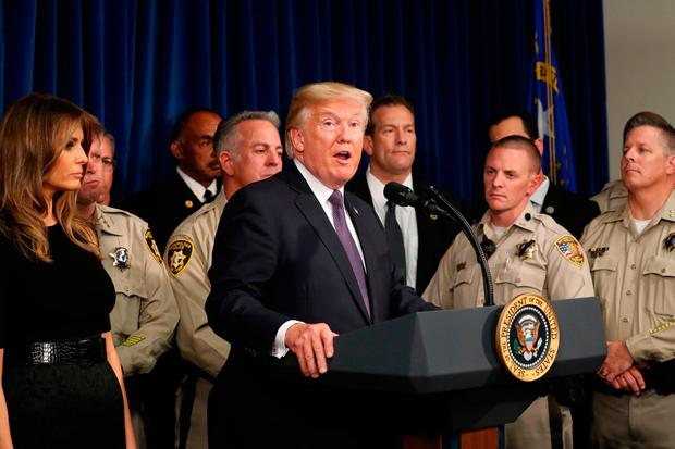 U.S. President Donald Trump speaks next to first lady Melania Trump after meeting with police at the Las Vegas Metropolitan Police Department in the wake of the mass shooting in Las Vegas, Nevada, U.S., October 4, 2017. REUTERS/Kevin Lamarque