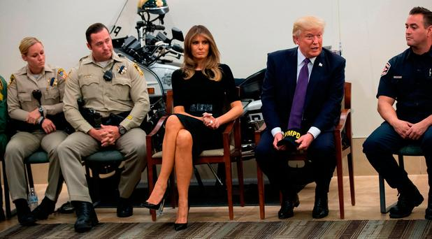 US President Donald Trump and first lady Melania Trump meet with police officers at Las Vegas Metropolitan Police Department headquarters, October 4, 2017 in Las Vegas (Photo by Drew Angerer/Getty Images)