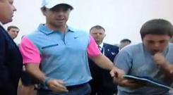 Rory McIlroy brushes off a young autograph hunter in 2014