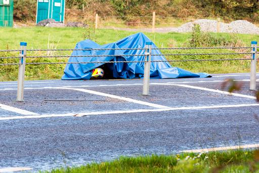 A canopy covers the garda motorcycle on the N20 early this morning. Picture: John Delea.