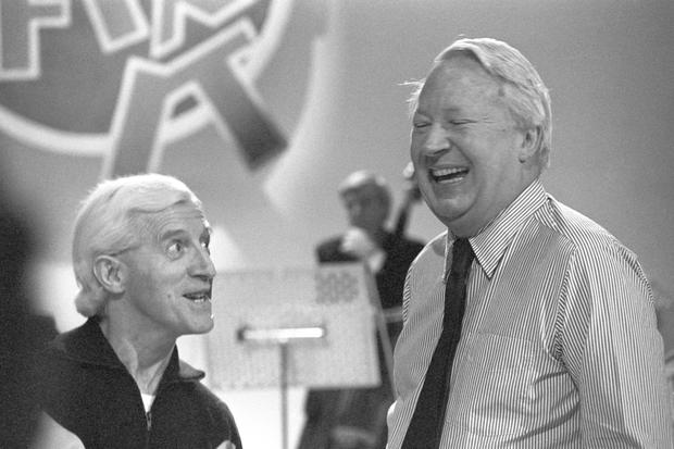 File photo dated 22/2/1980 of Former Prime Minister Edward Heath (right) and Jimmy Savile rehearse for an episode of Jim'll Fix It at the BBC Shepherd's Bush Theatre. Sir Edward would be questioned over allegations that he raped and indecently assaulted boys as young as 10 were he alive today, a controversial police report has said. PRESS ASSOCIATION Photo. Issue date: Thursday October 5, 2017. A Wiltshire Police investigation, called Operation Conifer, concluded that seven of the claims would have been sufficiently credible to justify questioning Sir Edward, who was prime minister between 1970 and 1974, under caution. See PA story INQUIRY Heath. Photo credit should read: PA Wire
