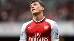 Mesut Ozil has often cut a forlorn figure this season CREDIT: GETTY IMAGES