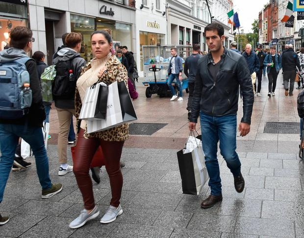 A make-up free Kelly Brook and boyfriend Jeremy Parisi spotted shopping on Grafton Street carrying Brown Thomas bags
