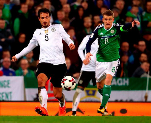Northern Ireland's Steven Davis (right) and Germany's Mats Hummels. Photo: Niall Carson/PA Wire