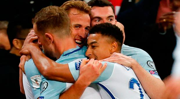 England's striker Harry Kane celebrates with team-mates after scoring
