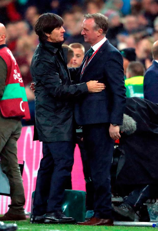 Northern Ireland manager Michael O'Neill (right) and Germany manager Joachim Low