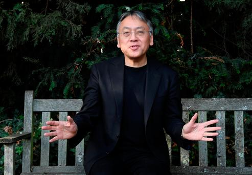 Kazuo Ishiguro speaks to the media outside his home, following the announcement he has won the Nobel Prize for Literature. Picture: Reuters
