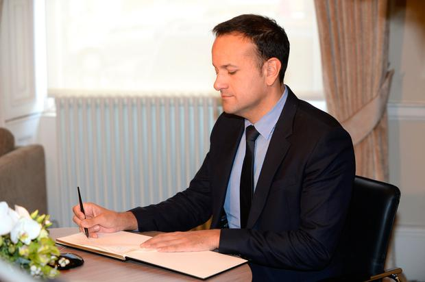 Taoiseach Leo Varadkar signs a book of condolence for Liam Cosgrave at Fine Gael's office in Dublin. Photo: Justin Farrelly.