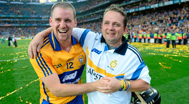 Clare manager Davy Fitzgerald celebrates with Colin Ryan after his side's All Ireland win in 2013