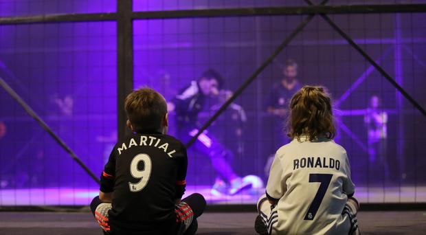 Kids watch the Street soccer 3v3 matches during the Soccerex Festival of Football on September 3rd, 2017 in Manchester, England. (Photo by Lynne Cameron/Getty Images)