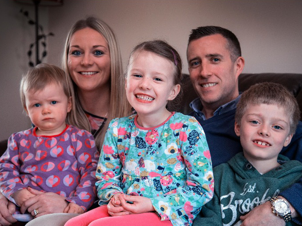 Pádraig and Clare McGhee with their children Muireann (18 mths), Laoise (5) and Ciaran (7) at their Kilcock, Co. KIldare home last night. Photo: Colin O'Riordan