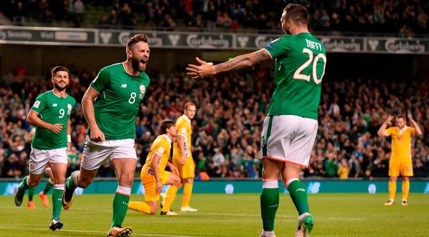 Daryl Murphy, left, of Republic of Ireland celebrates with team-mate Shane Duffy after scoring his side's first goal during the FIFA World Cup Qualifier Group D match between Republic of Ireland and Moldova at Aviva Stadium in Dublin. Photo by Eóin Noonan/Sportsfile