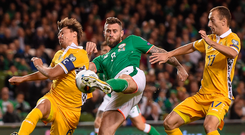 Concentration is the name of the game as Daryl Murphy strikes the opening goal against Moldova at the Aviva Stadium last night. Photo: Sportsfile