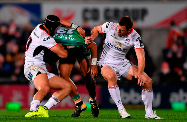Bundee Aki of Connacht is tackled by Christian Lealiifano of Ulster. Photo by Ramsey Cardy/Sportsfile