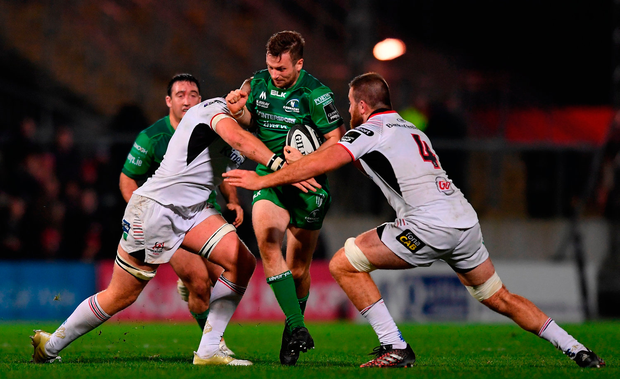 Jack Carty of Connacht is tackled by Kieran Treadwell, left, and Alan O'Connor of Ulster. Photo by Ramsey Cardy/Sportsfile