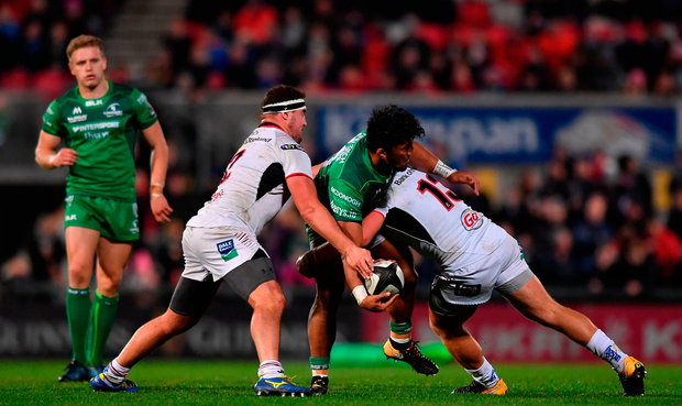 Bundee Aki of Connacht is tackled by Rob Herring, left, and Luke Marshall of Ulster. Photo by Ramsey Cardy/Sportsfile