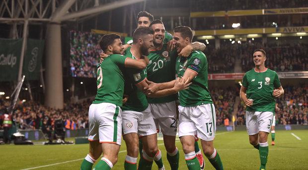 Daryl Murphy, second from left, of Republic of Ireland celebrates with team-mates, from left to right, Shane Long, Shane Duffy and Stephen Ward after scoring his side's first goal during the FIFA World Cup Qualifier Group D match between Republic of Ireland and Moldova at Aviva Stadium, in Dublin. Photo by Stephen McCarthy/Sportsfile