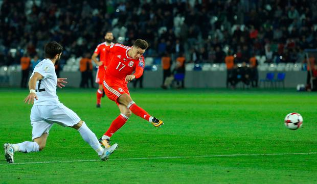 Tom Lawrence fires Wales into the lead in Tbilisi. Photo: PA