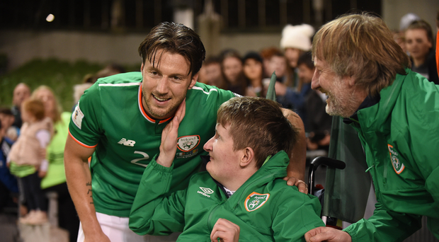 Harry Arter of Republic of Ireland poses for a picture with Jamie Monaghan and his dad Philip, from Togher, Co Offaly, after the FIFA World Cup Qualifier Group D match between Republic of Ireland and Moldova at Aviva Stadium in Dublin. Photo by Cody Glenn/Sportsfile