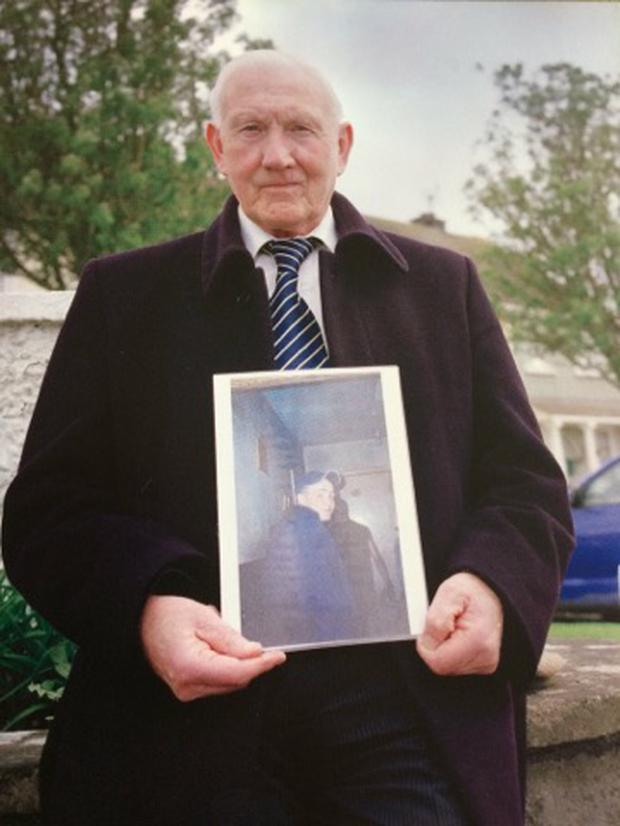 Martin Kehoe with a picture of his grandson Martin Doyle, who has been missing for 13 years