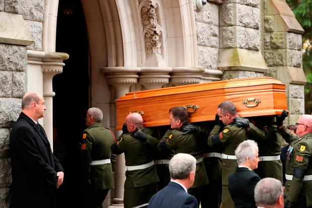 The coffin of former taoiseach Liam Cosgrave is carried into the Church of the Annunciation in Rathfarnham in Dublin, for his funeral service. Credit: Niall Carson/PA Wire