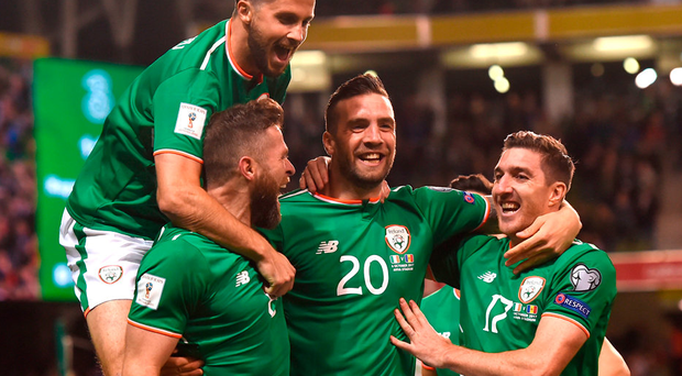 Daryl Murphy celebrates with team-mates Shane Long, Shane Duffy and Stephen Ward after scoring his first goal against Moldova on Friday night. Photo: Sportsfile