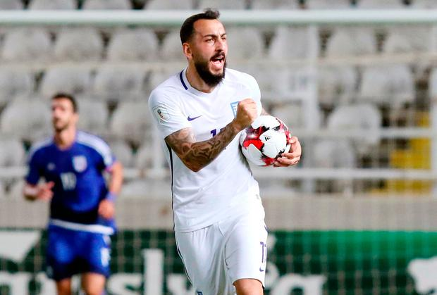 Greece's forward Konstantinos Mitroglou celebrates his equalising goal during their World Cup 2018 qualifying Group H football match between Cyprus and Greece at the NEO GSP Stadium in Nicosia on October 7, 2017. / AFP PHOTO / SAKIS SAVVIDESSAKIS SAVVIDES/AFP/Getty Images