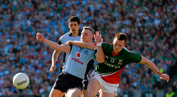 22 September 2013; Philip McMahon, Dublin, is tackled by Cillian O'Connor, Mayo. GAA Football All-Ireland Senior Championship Final, Dublin v Mayo, Croke Park, Dublin. Picture credit: Ray McManus / SPORTSFILE