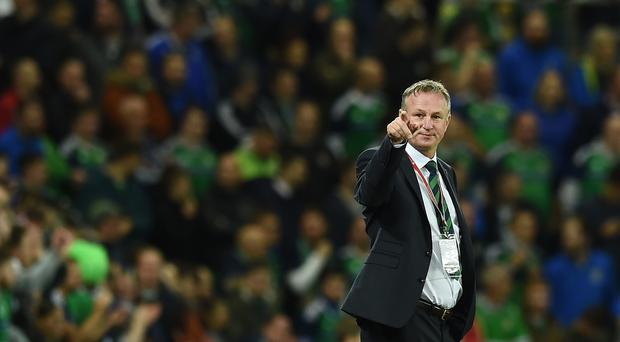 Northern Ireland assured of play-off place following Scotland's draw in Slovenia