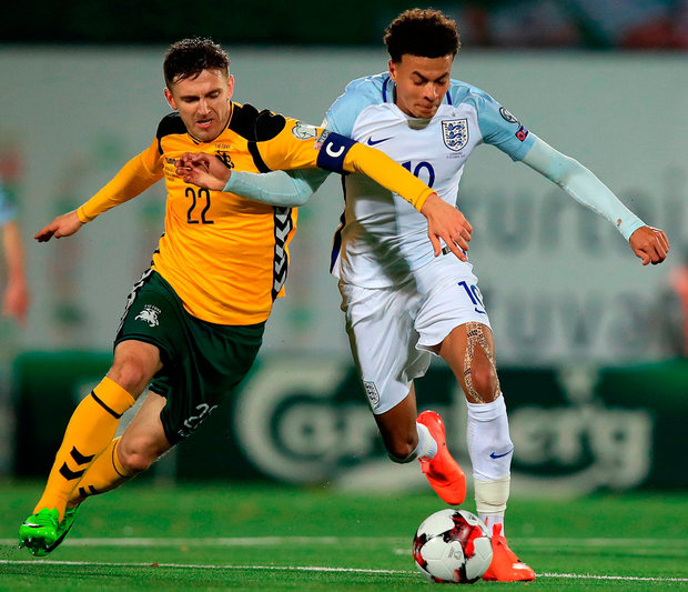 Lithaunia's Fedor Cernych (left) and England's Dele Alli battle for the ball during their World Cup Qualifying match in Vilnius. Photo: Mike Egerton/PA